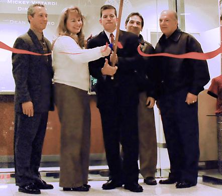 Mayor Dean DePiero, Recreation Director Mickey Vittardi, and members of Parma City Council cut the ribbon at the new Parks and Recreation offices located at Parmatown Mall.
